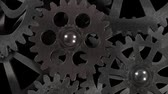 mecanismo : Metal gear mechanism rotates slowly on a black background, 3D rendering Stock Footage