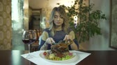 golosità : Attractive tattooed girl young woman waiting to eat huge piece of fried meat with hands in fancy restaurant