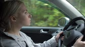 encanto : The young girl behind the wheel of a car