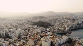 kreta : Aerial view of city Agios Nikolaos on a cloudy day. 4K