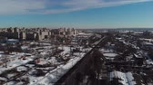 郊外の : Cityscape railroad tracks at winter day. Aerial view. Railway on the outskirts of the city. 4K