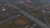 ring road : Top view of a major road in the city. Top view of the road junction. The camera is flying over the radius of the road junction. Aerial view 4K