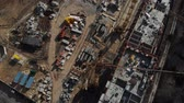 reparação : Drone flying over a construction site with a top down view. The camera flies superstructure, top-down view. Aerial view 4K