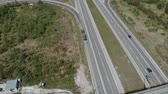 caqui : Military vehicles are on the side of the road in front of the bridge. Aerial view 4K