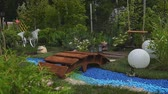 Landscape design. Flowers. Pink flamingo. Childrens sandbox. Football