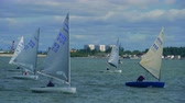Regatta on childrens yachts. Teenagers competing on the yacht. 4k