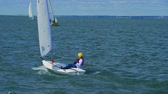 Sailing. Teenager yachtsman sailing on a yacht. 4K