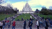 french culture : PARIS, FRANCE - MARCH 29, 2018: lot of people walking near the Basilica Sacre Coeur