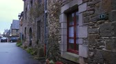 brittany : Ancient street with cobblestone road and historic houses, Brittany, France