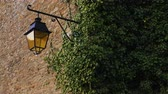 brittany : old street lantern on a stone wall Stock Footage