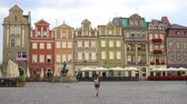 orientar : girl tourist walking by the main square Rynek of polish city Poznan