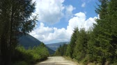 ground road at the mountains and clouds running in the blue sky