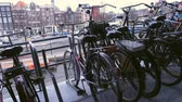 modo de transporte : AMSTERDAM, NETHERLANDS - MARCH 27: bike parking at the Amsterdam Centraal railway station