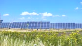 solar panels at the field at the hot sunny day with the blue sky at the background