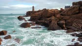 Phare de Men Ruz lighthouse at the Rose Granit Beach, Brittany, France Stok Video