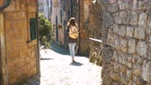 umbrie : young woman traveler walking on narrow streets of italian village