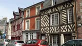 brittany : HONFLEUR, FRANCE - APRIL 08, 2018: view of empty beautiful street with old traditional houses at the center of Honfleur, Normandy, France
