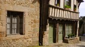 brittany : DINAN, FRANCE - APRIL 06, 2018: view of empty beautiful street with old traditional houses at the center of Dinan, Brittany, France
