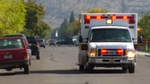 opieka : ambulance with lights driving down street