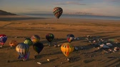 templombúcsú : hot air balloon festival shot from the air with lake in distance Stock mozgókép