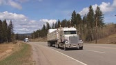 flatbed : tractor trailer hauling freight in british columbia Stock Footage