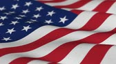 wind : Shallow depth of field - USA flag waving in the wind - highly detailed fabric texture - seamless looping