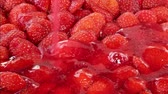 jello : Closeup of baker pouring hot, steaming glaze onto delicious strawberry cake. Stock Footage