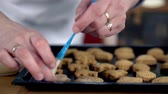 preparations : Woman adding top layer on cookies