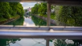 statue : Ljubljana, Slovenia - April 2014: Jib Shot of Ljubljana River With Green Trees Beside
