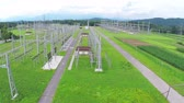 distribuidor : Aerial Power station distributor electric lines. Flying next to power distribution complex, supplying nearby city with electricity. Vídeos
