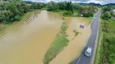 flooded road : Aerial shot of river flooding field by the road Stock Footage