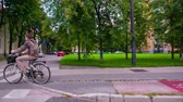 sideview : LJUBLJANA, SLOVENIA ? SEPTEMBER 2014: Overtake bicyclist in slow motion. Driving by a city bicyclist on cycle track.