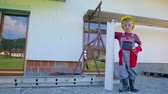 energy : Little worker proud of his work isolating house. Jib wide lens shot of very young worker with protective helmet and glasses and gloves posing in front of house being protected against moist. Stock Footage