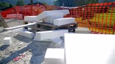 efficient : foam pieces all around construction site jib shot. Big white foam boards for placing on house walls protecting it against moisture.