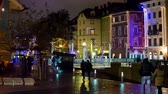 handheld : LJUBLJANA, SLOVENIA - DECEMBER 2014: Ljubljana city center at night around Christmas. Handheld shot of bright Ljubljana city center and people strolling around the Ljubljanica river.