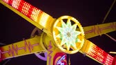 dispositivo : LJUBLJANA, SLOVENIA - DECEMBER 2014: Rotating device in amusement park. Close up of axis rotating with flashing lights at night. Vídeos