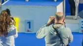 greyhound : LJUBLJANA, SLOVENIA - JANUARY 2015: Photographers at dog show exhibition. Long shot of professional photographers shooting dogs on winning podium.