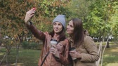 two young women take a selfie in autumn Park Vídeos