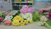 frezja : Female florist making beautiful bouquet at flower shop Wideo
