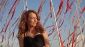 ribbon : Young beautiful woman spending time on the beach, summer time.dancing under developing tape Stock Footage