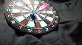 flechette : dart board   on black background.video taken in malaysia Vidéos Libres De Droits