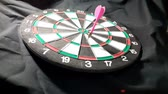 дартс : dart board   on black background.video taken in malaysia Стоковые видеозаписи