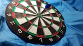 ダーツ : dart board on   blue background. video taken in malaysia