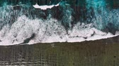 waves breaking on the shore : Aerial view of waves in tropical ocean and reef Stock Footage