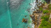 indonesia : Aerial view of rocky seacoast with ocean at Padang Padang, Bali. Stock Footage