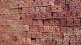 industrial background : stack of orange bricks, industrial construction concept