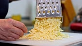 аппетитный : Cheese grater and cheddar cheese