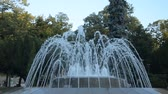 serbia : Fountain in a public park in Vrnjacka Banja, Serbia, changing shapes of spraying water, early in the morning