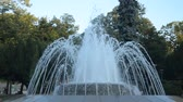 pó : Fountain in a public park in Vrnjacka Banja, Serbia, changing shapes of spraying water, early in the morning