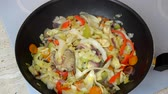teaspoon : Spicing up fried vegetables in a wok during a cooking process